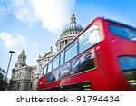 Double decker passing by front of St Paul's Cathedral. - stock photo