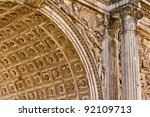 An ancient Roman arch with intricate details - stock photo