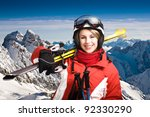 A woman skiing in the Alps, outdoor shoot. - stock photo