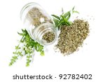 Glass bottle with basil on white background - stock photo