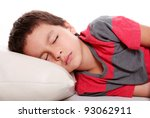 Child sleeping on white pillow and empty background, studio shoot - stock photo