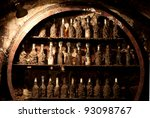 Old wine cellar with many dusty wine bottles - stock photo