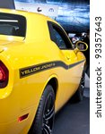DETROIT - JANUARY 22: The Dodge SRT Challenger Yellow Jacket on display at the North American International Auto Show on January 22, 2011 in Detroit, Michigan. - stock photo