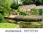Picturesque garden in the Cotswold village of Bibury, England - stock photo