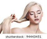 Beautiful Blonde Girl. Healthy Long Hair. Space For Text - stock photo