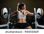 Sporty sexy woman in gym - stock photo