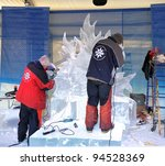 OTTAWA, CANADA - FEB 4: Ice sculptors at work during the Winterlude Festival on February 4, 2012 in Ottawa, Ontario, Canada. - stock photo