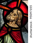 Stained glass window detail of face of Jesus during Agony in the Garden - stock photo