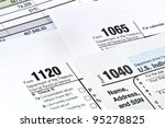 Tax forms 1040,1120,1065 - stock photo