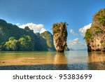 View of Ko Tapu island known as James Bond Island near Phuket from wet sandy coast - stock photo