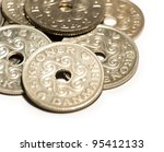 Coins with hearts and holes, close-up - stock photo