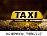 Taxi sign in rainy day - stock photo