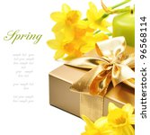 Golden gift box with springtime narcissus - stock photo