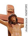 Christ Jesus hanging on a wooden cross - stock photo