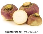 fresh turnips and a cut one on a white background - stock photo