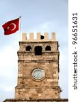 View of the Roman Clock Tower with Turkish flag in Antalya, Turkey - stock photo