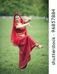 Young woman performing Indian dance - stock photo