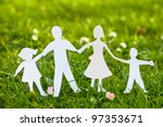 Family paper on grass - stock photo