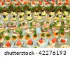 a lot of canapes with skewers and sandwiches on buffet table, shallow DOF - stock photo