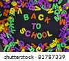 Back to School title written of rubber letters on the black background - stock photo