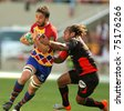 BARCELONA - APRIL 9: Perpignan's Guiry is tackled by Toulon's Gabiriele during the Heineken European Cup match USAP Perpignan against RC Toulon at the Olympic Stadium in Barcelona, on April 9, 2011 - stock photo