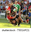 BARCELONA - APRIL 9: Toulons's Loamanu is tackled by Perpignan's player during the European Cup match between USAP Perpignan and RC Toulon at the Olympic Stadium in Barcelona, on April 9, 2011 - stock photo