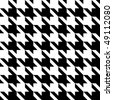 Black and white seamless houndstooth pattern or texture. - stock photo