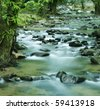 flowing water of mountain stream - stock photo
