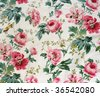 Fragment of colorful retro tapestry textile pattern with floral ornament and flowers useful as background - stock photo