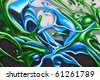 Fragment of the colorful graffiti on the wall - stock photo