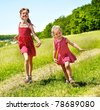 Group children running across green grass outdoor. - stock photo