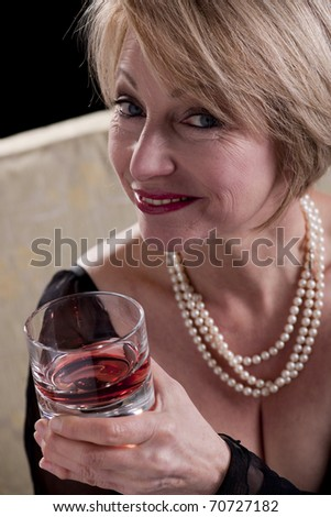 Happy Mature Woman With Drink stock image