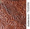 Leatherwork carved detail on saddle - stock photo