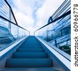 moving walkway to the blue sky and cloud of a city outdoor. - stock photo