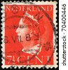 NETHERLANDS - CIRCA 1947: A stamp printed in the Netherlands shows Queen Wilhelmina, series, circa 1947 - stock photo