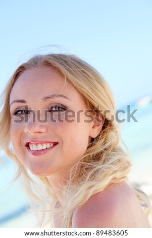 stock photo portrait of beautiful woman in bikini at the beach 89483605 Police: Man recorded neighborhood kids undressing