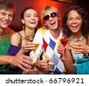 Portrait of young people with flutes laughing in the nightclub - stock photo