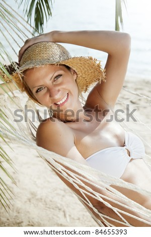 Smiling woman lying in a hammock stock image