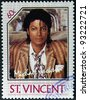 ST. VINCENT - CIRCA 1985: A stamp printed in St. Vincent shows Michael Jackson, circa 1985 - stock photo