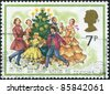 UNITED KINGDOM - CIRCA 1978: A stamp printed in England, is shown Carolers Around Christmas Tree, circa 1978 - stock photo