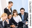 Young happy smiling successful businesspeople at meeting, presentation or conference - stock photo