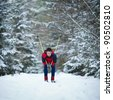young man cross-country skiing on a snowy forest trail (color toned image) - stock photo