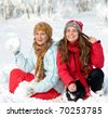 young women enjoying the snow - stock photo