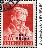 YUGOSLAVIA-CIRCA 1953: A stamp printed in Yugoslavia shows Nikola Tesla, circa 1953 - stock photo